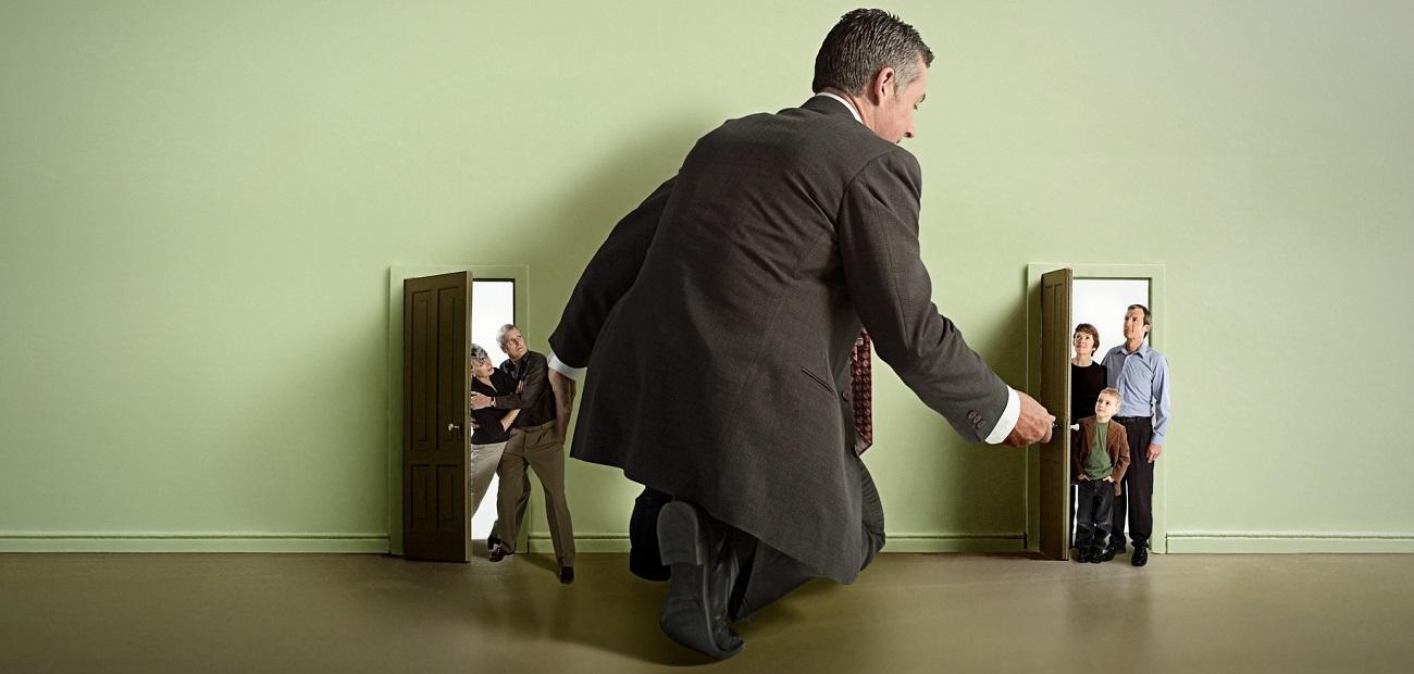 Man managing house guests in doorway