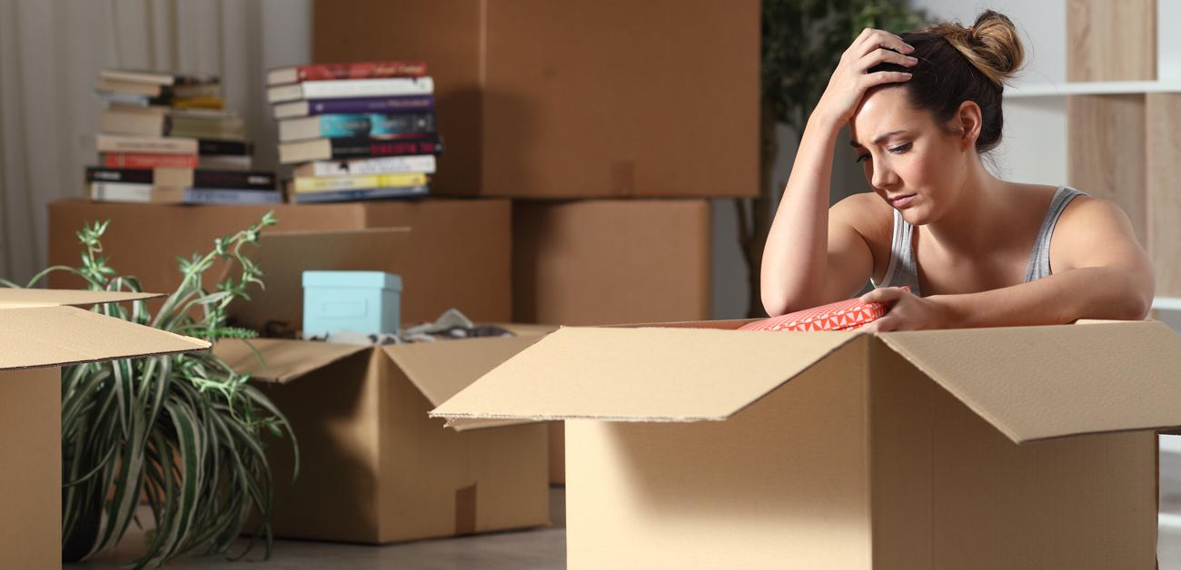 woman packing up apartment