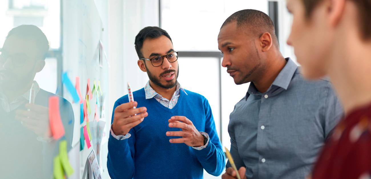 group of 3 having marketing meeting