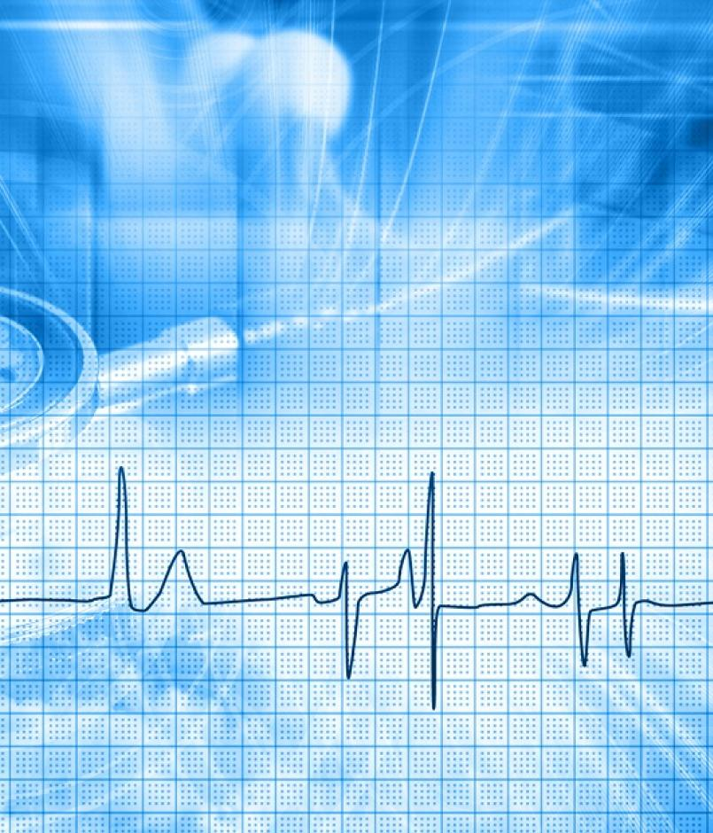 Abstract medical backdrop with stethoscope and heart trace