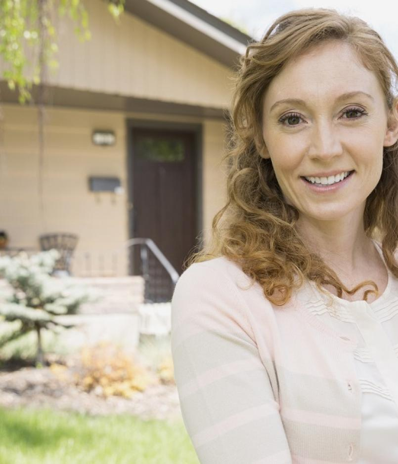 Portrait of confident realtor outside house