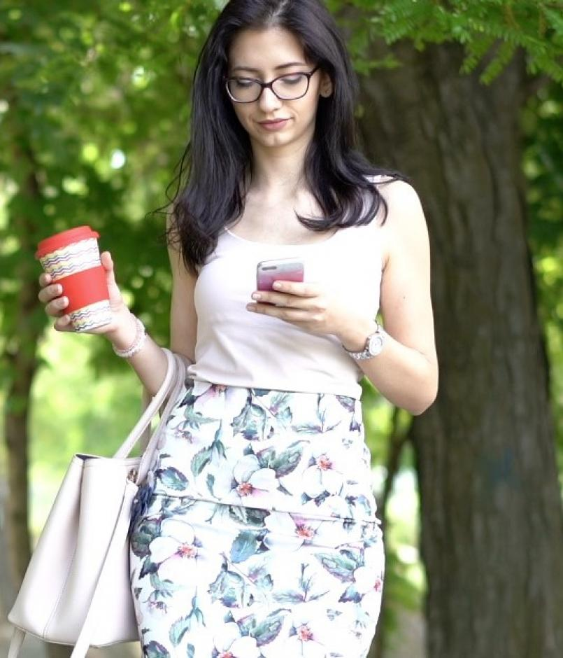 Woman walking while looking at smartphone