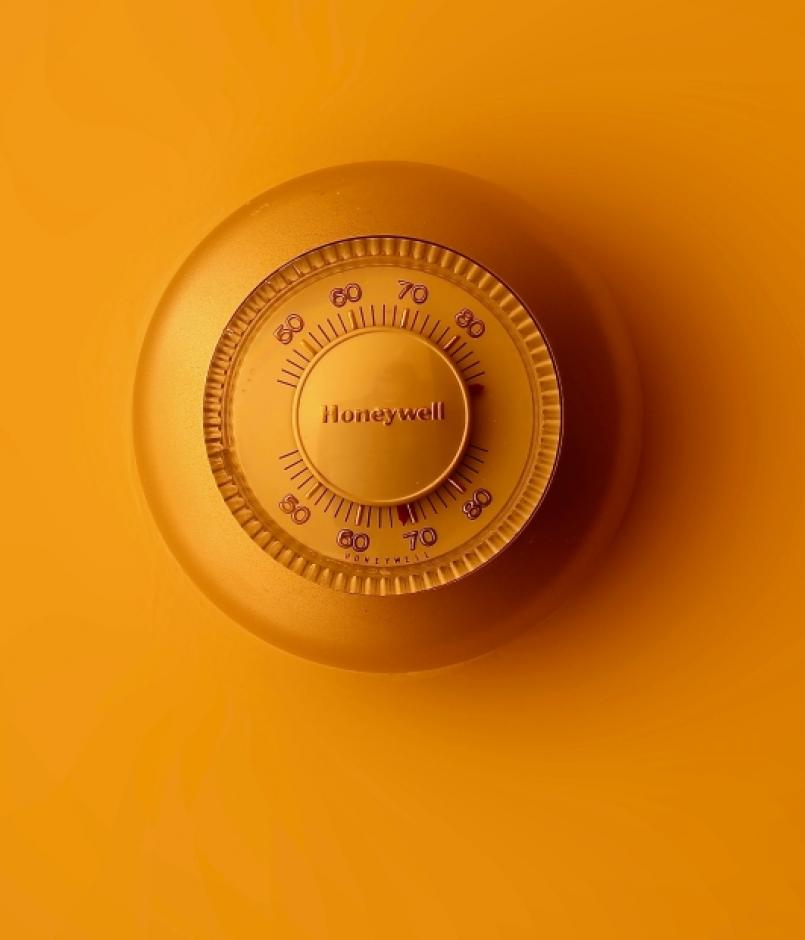 An old-fashioned thermostat on a wall