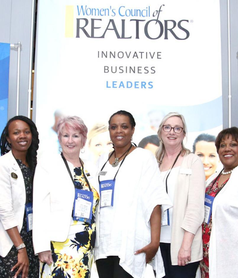 Members pose in front of signage during the Women's Council of REALTORS® Networking Reception & Best of Women's Council Awards.