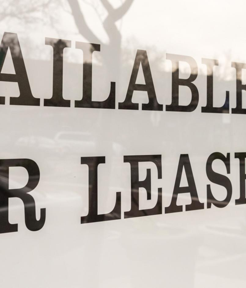 space for lease sign in vacant storefront