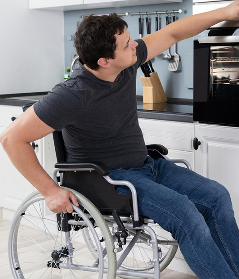 Man in Wheelchair Using Adapted Oven