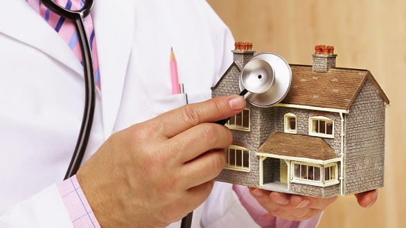 Doctor's stethoscope on model of house