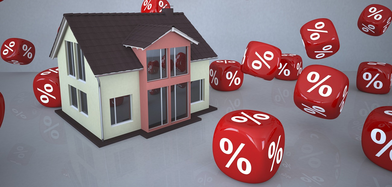 Residential house surrounded by percentage sign cubes