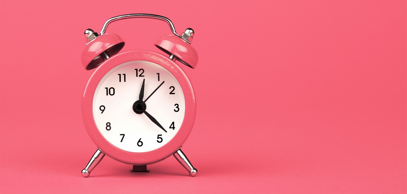 Alarm Clock Against Pink Background