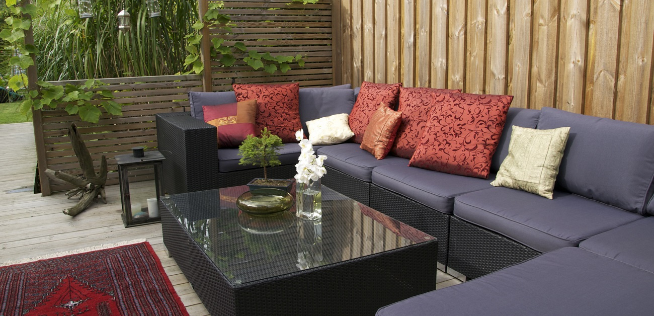 Contemporary patio with large wicker sofa