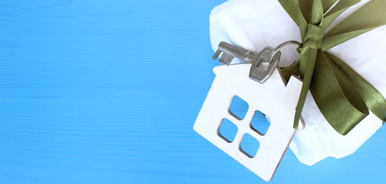 Gift with house-shaped keychain attached