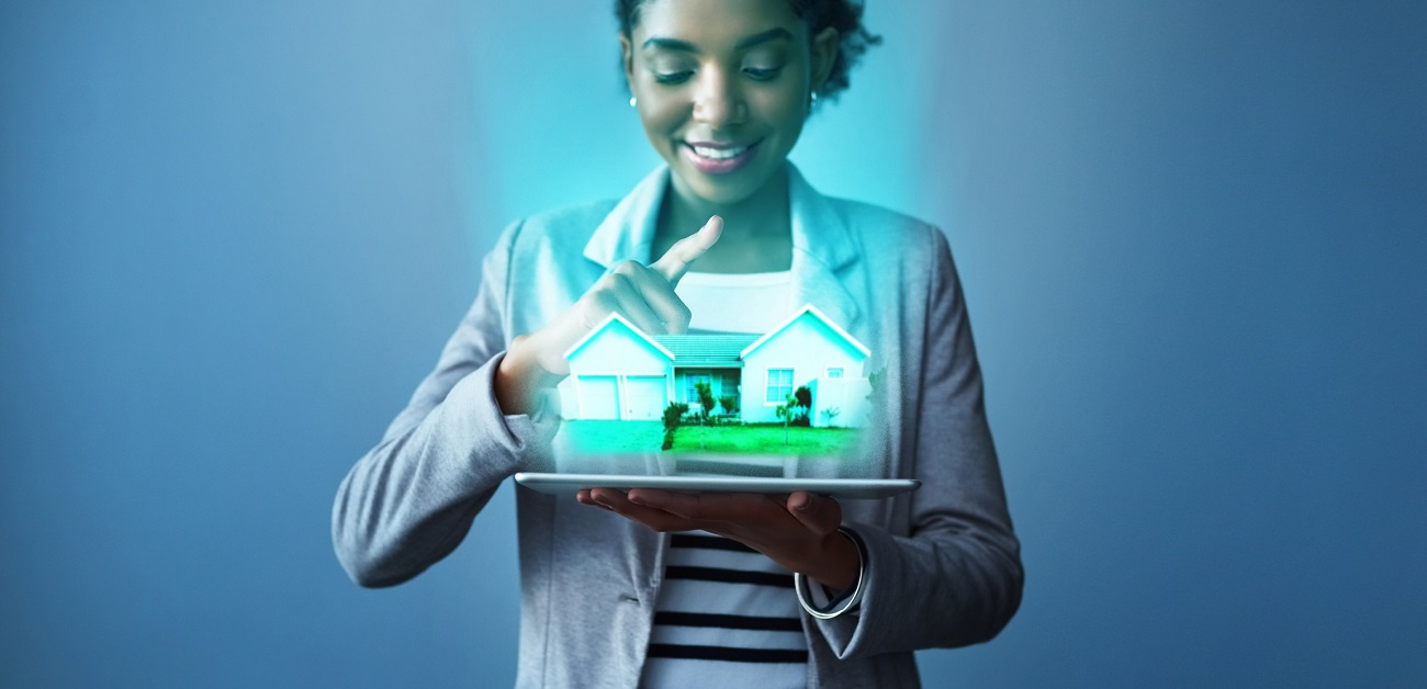 young businesswoman using a digital tablet with property graphics
