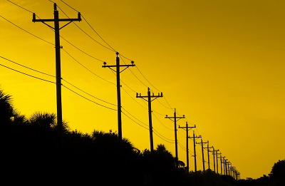Power lines against a yellow background