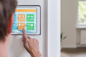 Homeowner operating smart-home device