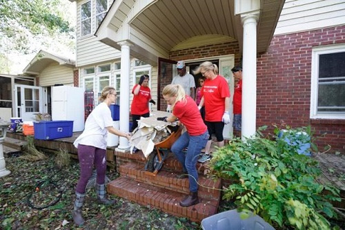 A KW Cares team helps clean a property that was flooded by Hurricane Florence.