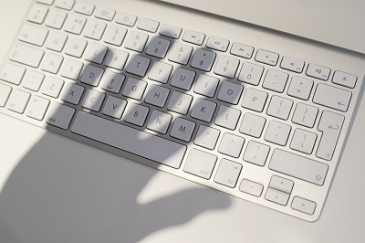 Hand shadow casted over keywboard