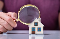 Magnifying glass and model home