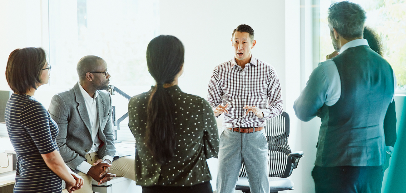 Businessman leading discussion during meeting in office