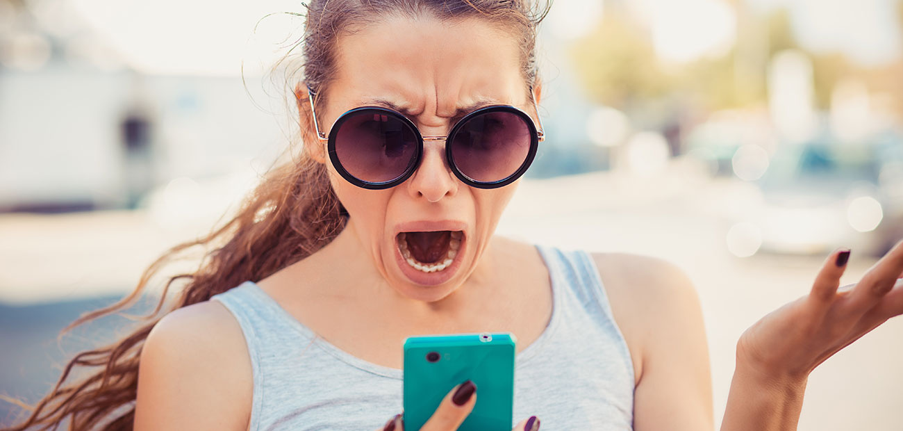 shocked woman reading text on phone