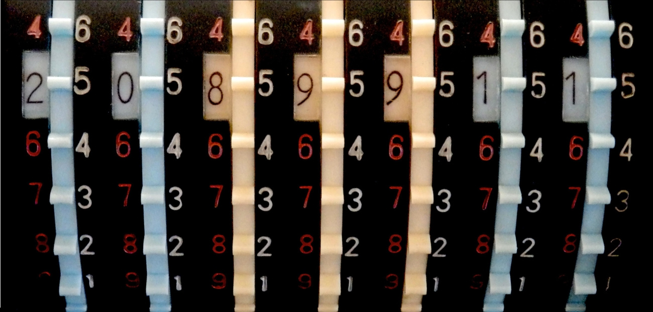 An old-fashioned adding machine with a variety of numbers