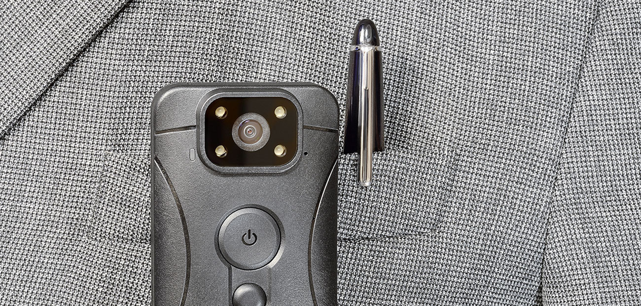 body cam on jacket pocket with pen