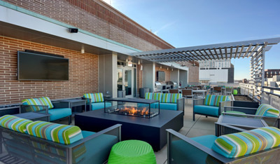 Terrace at ViVo, with outdoor TV, shade structure, deep seating, Mary Cook Associates