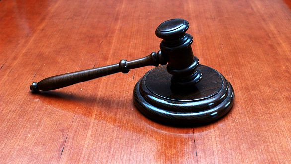Gavel on wood surface