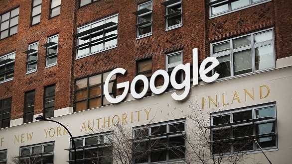 Google sign on exterior of brick building