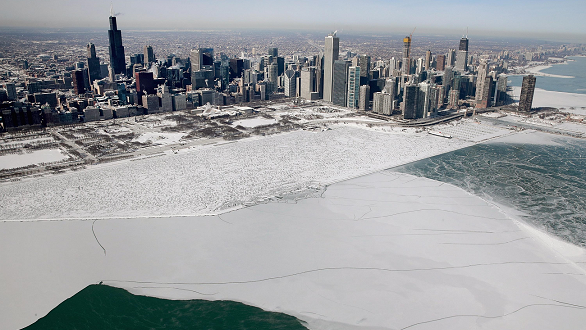 Chicago skyline in back of ice-covered Lake Michigan