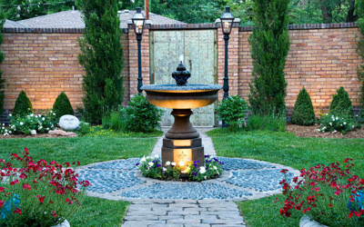 small garden with path, water fountain