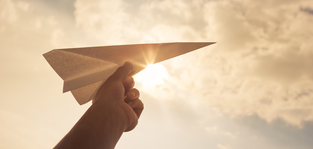 paper airplane against sky