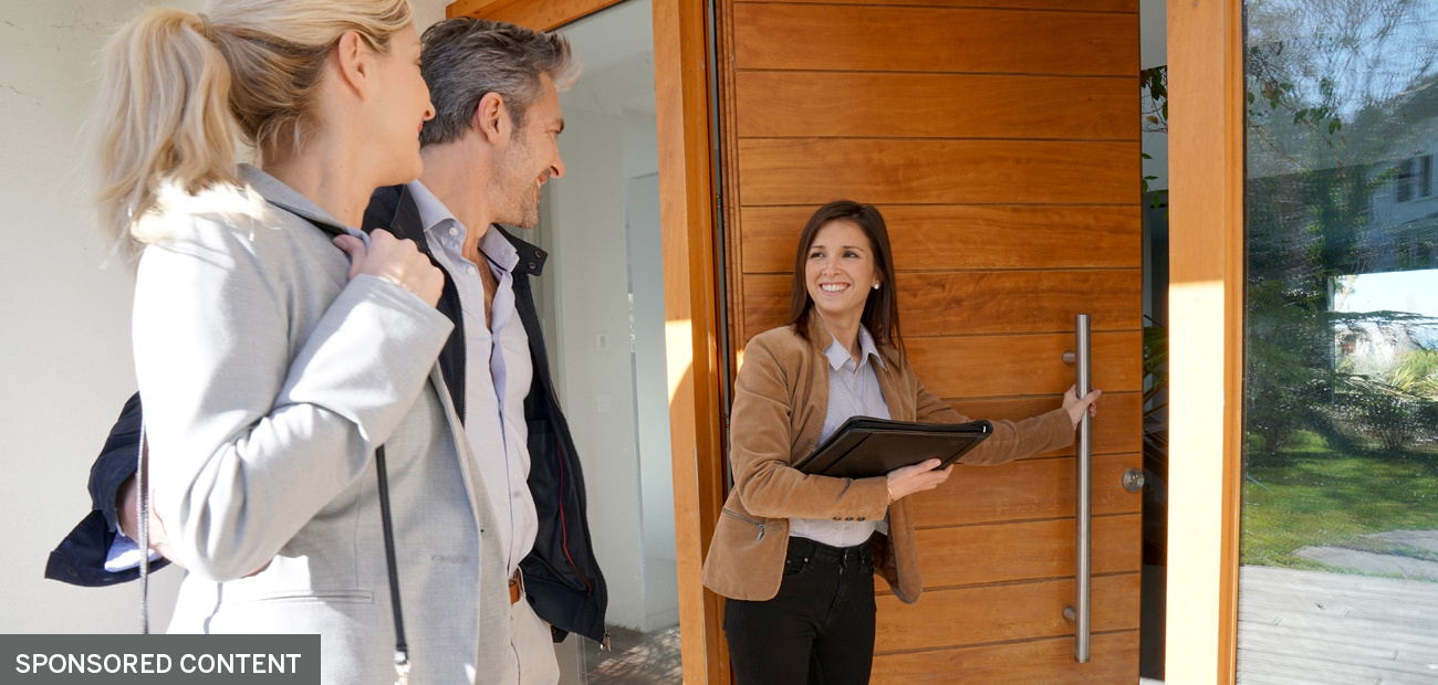agent with clients entering home
