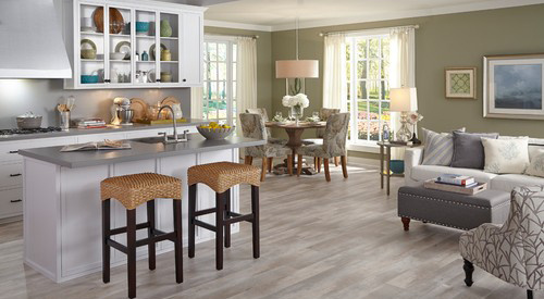 open floor plan kitchen and living room with luxury vinyl flooring