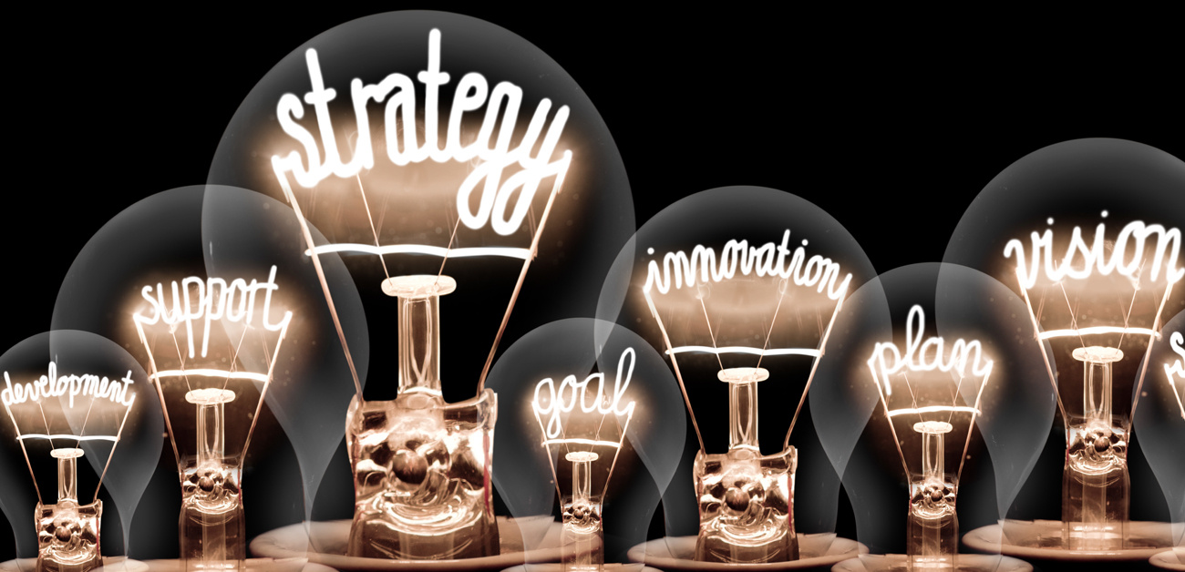 lightbulbs with leadership  buzzwords