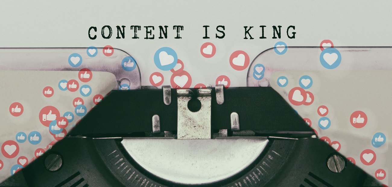 "detail of old typewriter; ""Content is King"" text on paper; social media ""likes"" cover page."