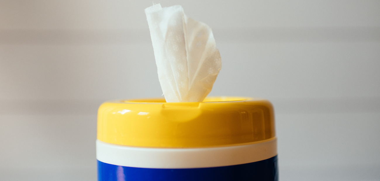 Container of disinfecting wipes