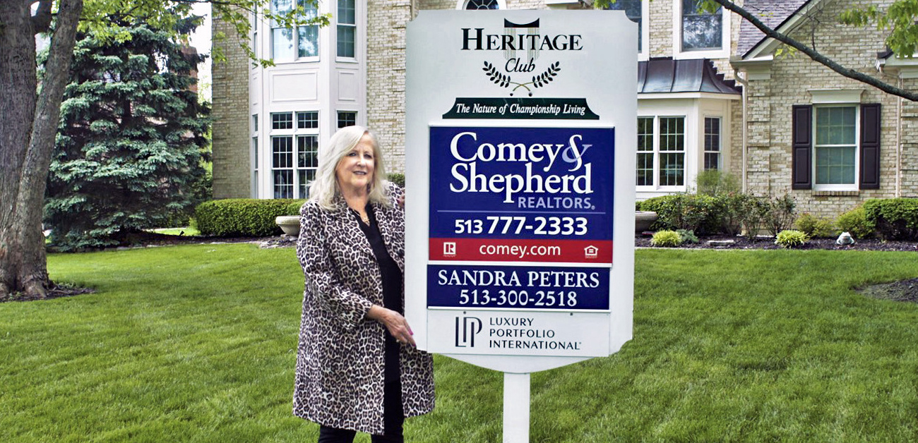 Sandra Peters at one of her listings