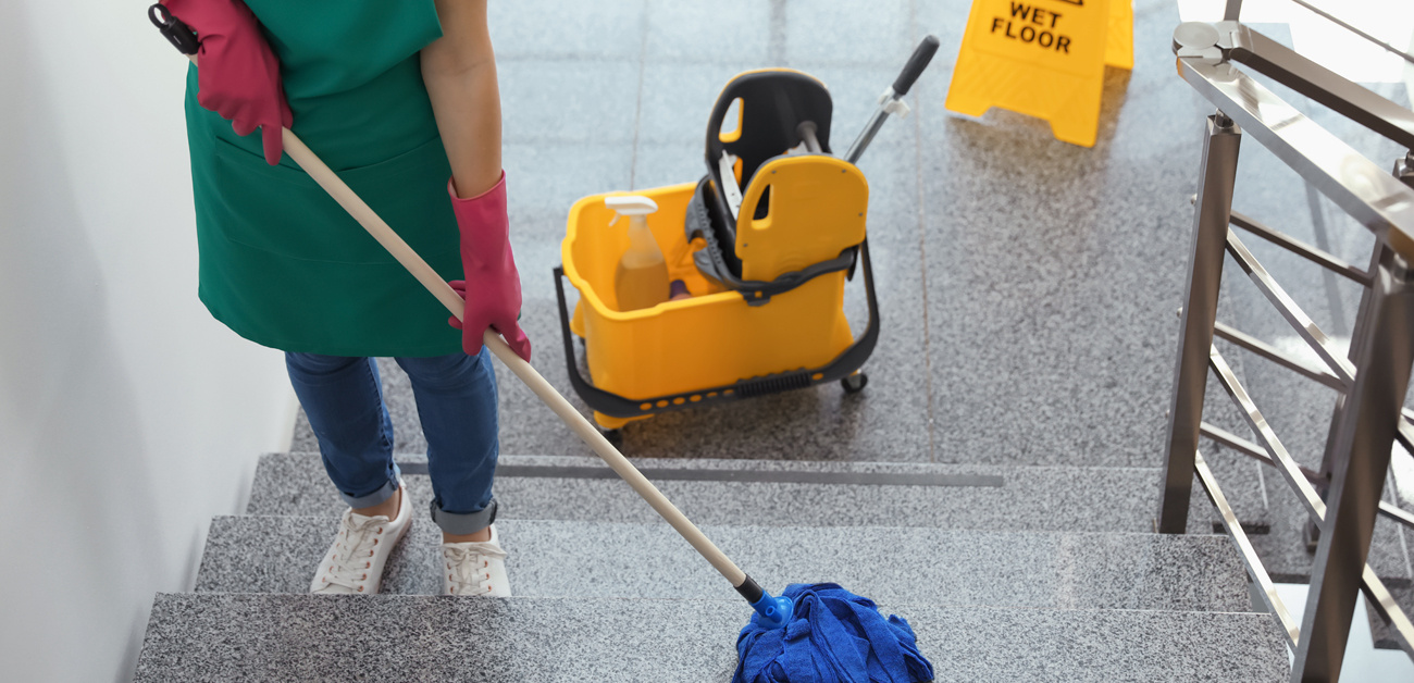 commercial cleaning service mopping floors