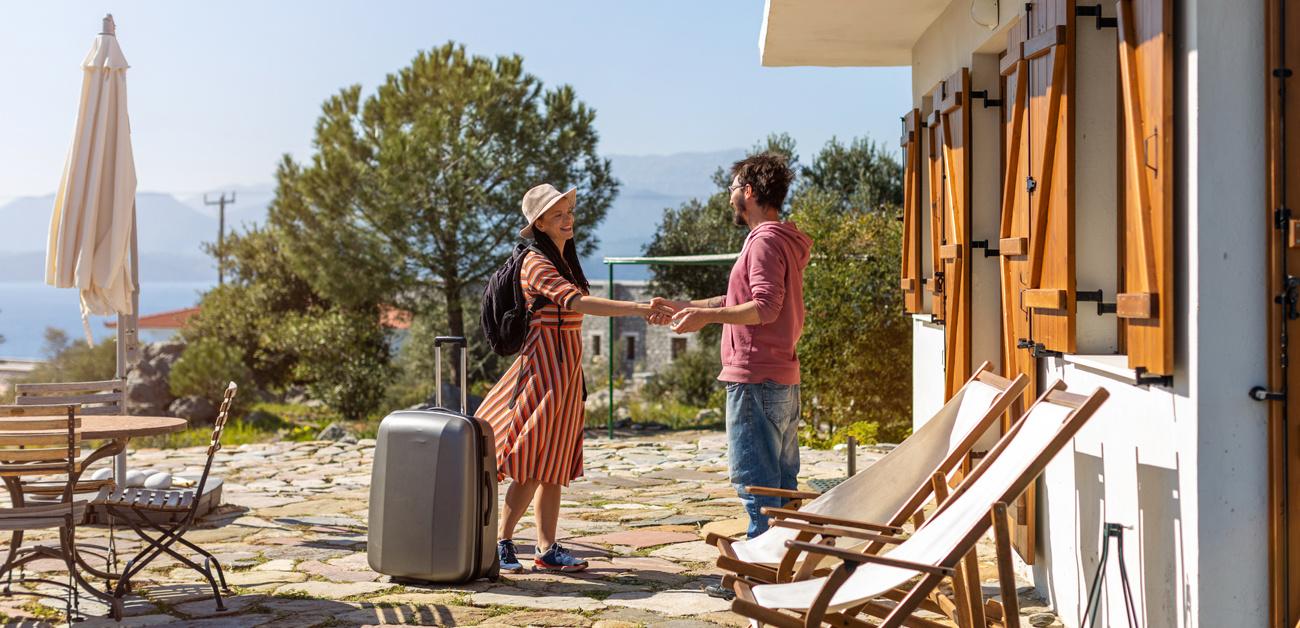 woman arriving at vacation rental