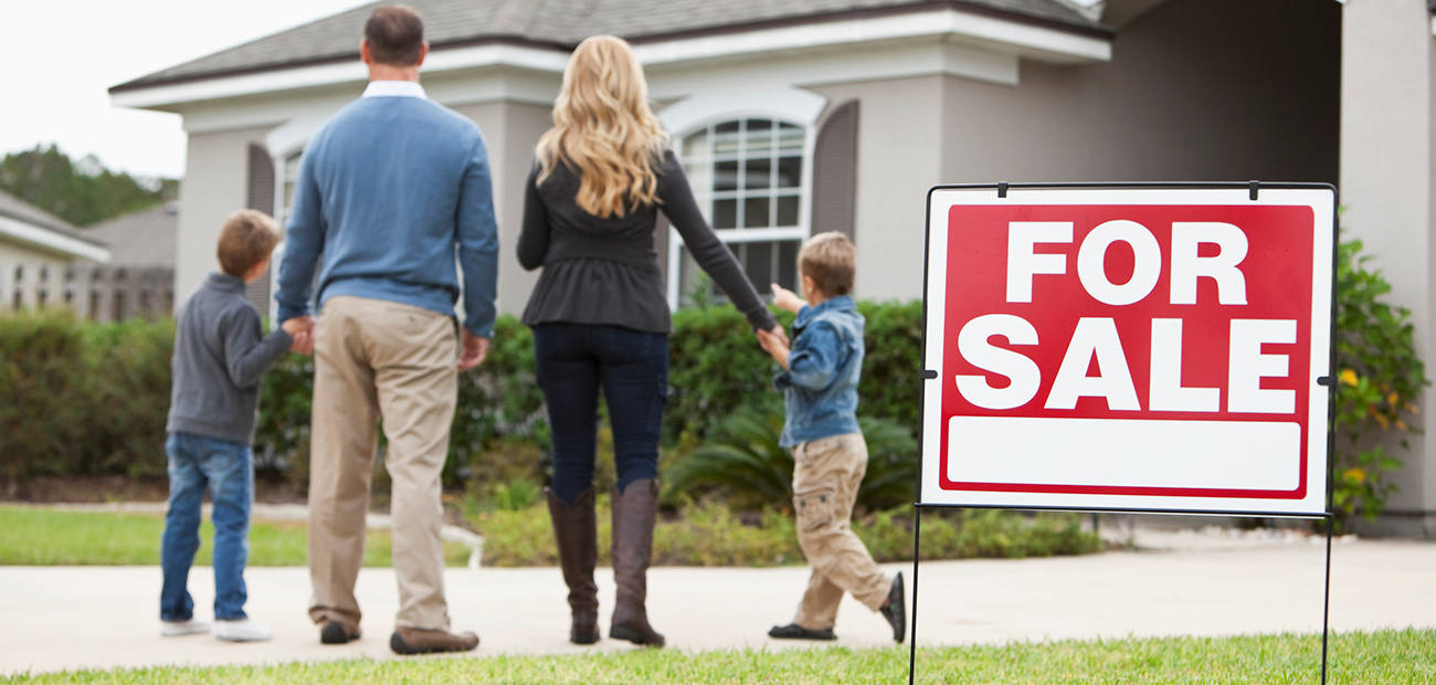 Family With For Sale Sign