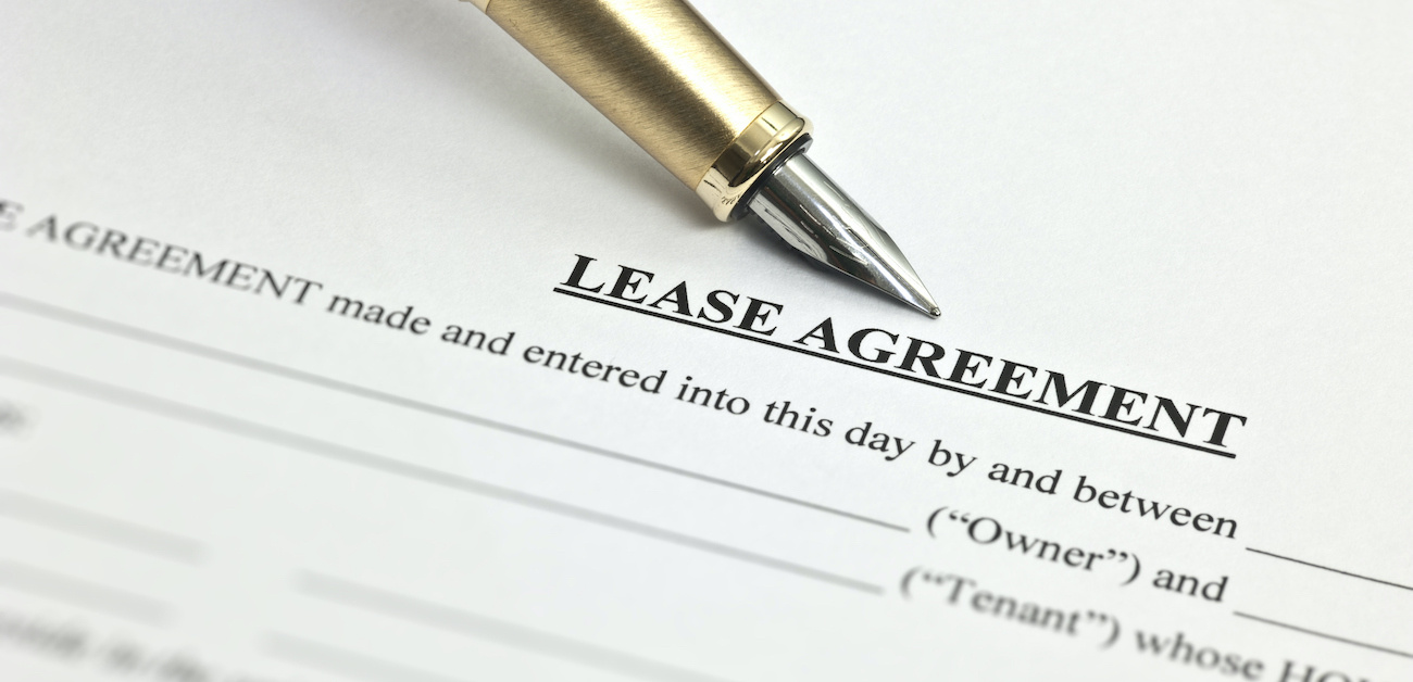 Lease agreement form with pen.