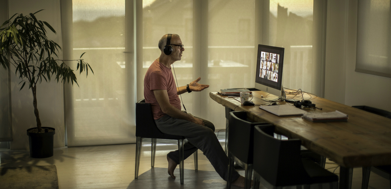 Man on video call from home
