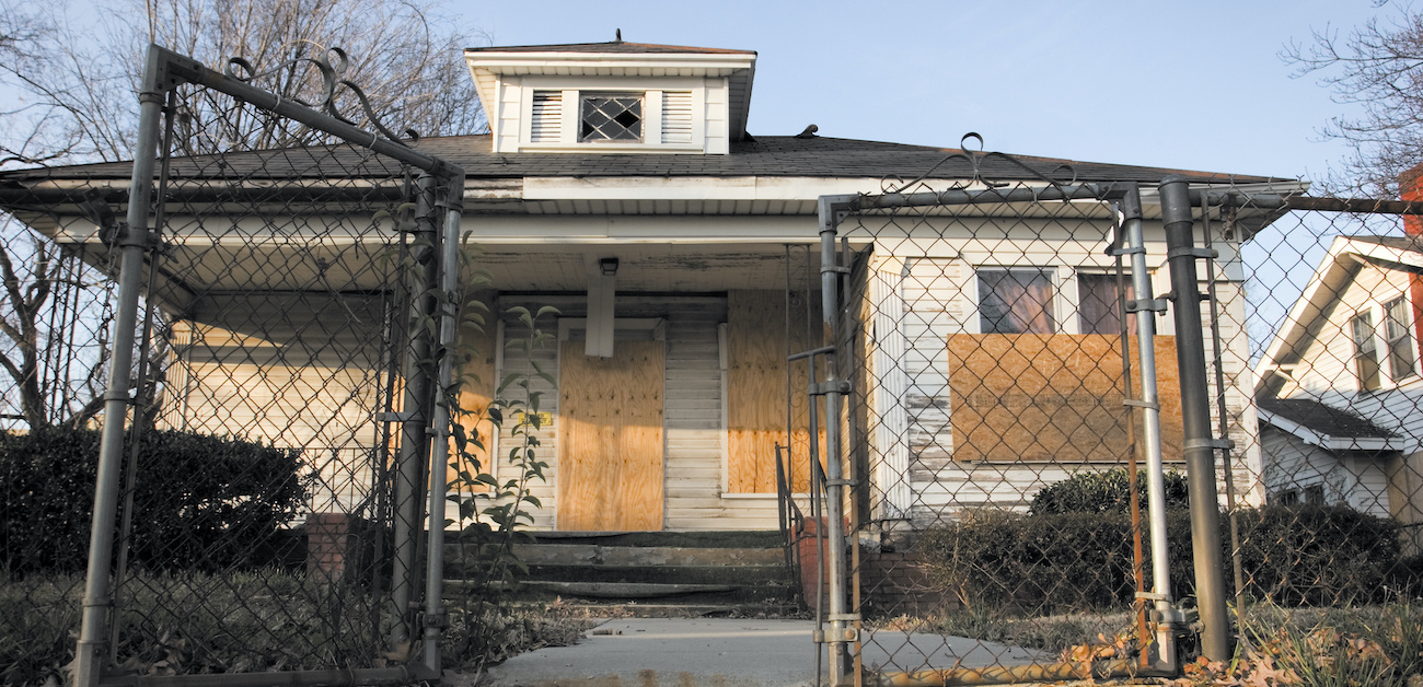 Vacant, boarded up house.