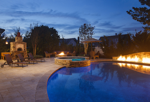 Backyard pool with fire pit and accents
