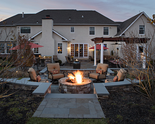 Ourdoor patio with firepit, seating, and pergola