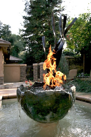 Pool with fountain and fire element.