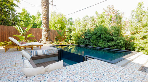 Container pool surrounded by tile deck.