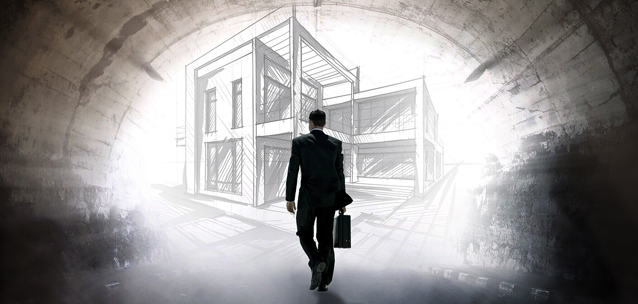 Man Walking With Briefcase in Front of New Building