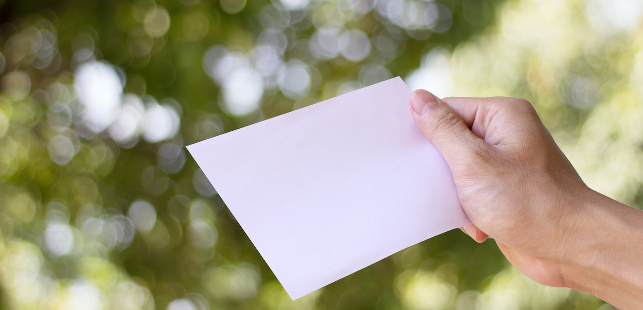 Man holding up a letter