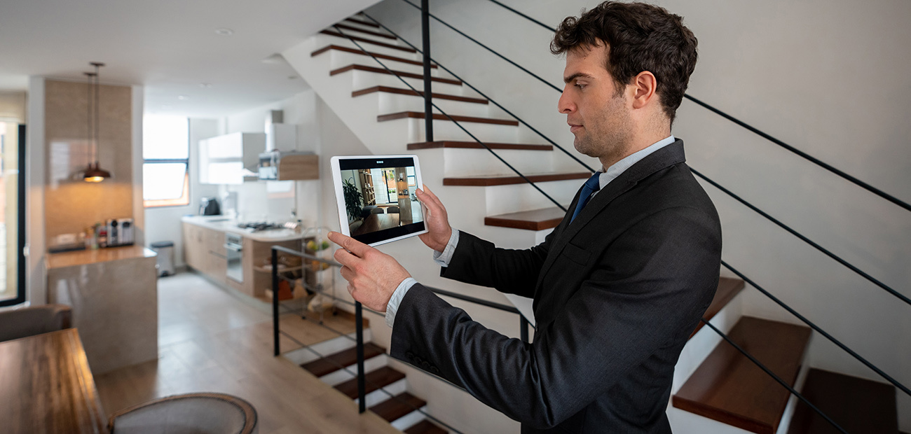 Man Taking Photos With Tablet